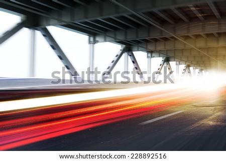 Vehicle light trails on a modern bridge.Photo realistic 3D rendered scene. - stock photo