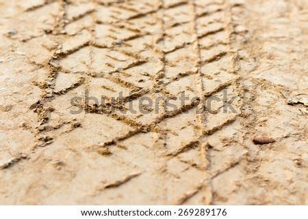 Vehicle track on dirt, depth of field effect - stock photo