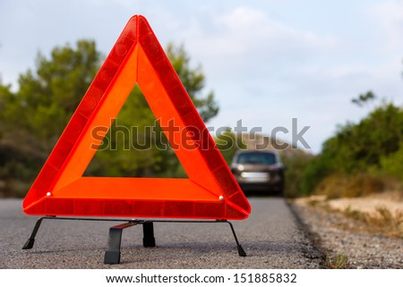 Vehicle with problems and a warning triangle
