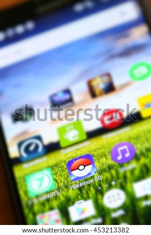 VELIKA GORICA, CROATIA- JULY 15, 2016 : Macro close up image of Pokemon Go game app icon among other icons on a smartphone device. Pokemon Go is a popular virtual reality game for mobile devices. - stock photo