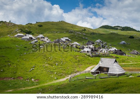 Velika Planina, Slovenia - July 2013. Traditional village of mountain houses on Velika Planina, Slovenia. It is great hiking location allowing you to tase different diary products by local shepherds.  - stock photo
