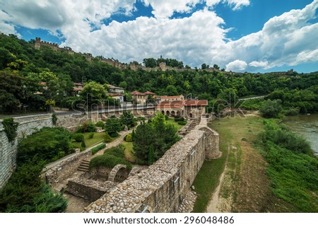 Veliko Tarnovo, the historical capital of Bulgaria. Historical city walls and beautiful mountain cityscape. Beautiful touristic destination in Eastern and Central Europe. - stock photo