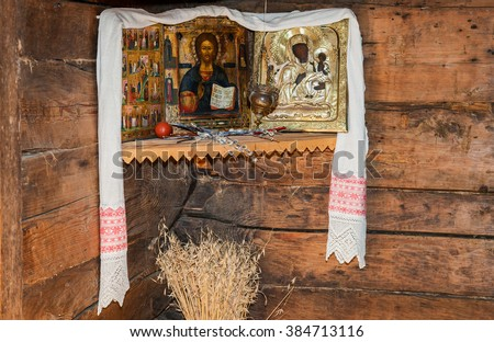 VELIKY NOVGOROD - JULY 23, 2014: Interior of old rural wooden house in the museum of wooden architecture Vitoslavlitsy. Antique Russian orthodox icons painted on wooden board - stock photo