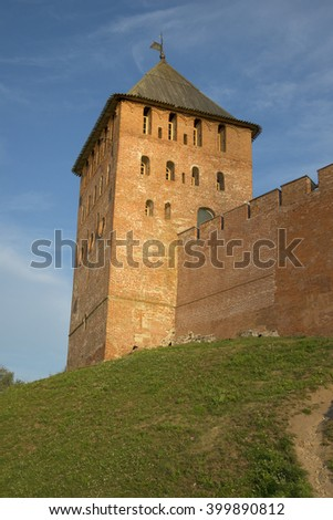 VELIKY NOVGOROD, RUSSIA - AUGUST 04, 2014: Palace tower of the Kremlin of Veliky Novgorod in the rays of the rising sun