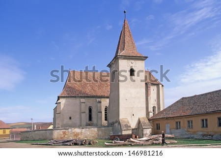 VELT, TRANSYLVANIA, ROMANIA - APRIL 3: Fortified church of Velt on April 3, 2000 in Velt Transylvania, Romania. The fortified churches are important part of transylvanian culture.