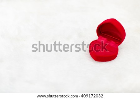 Velvet red box on white carpet background, Valentine's day, love concept, marry me - stock photo