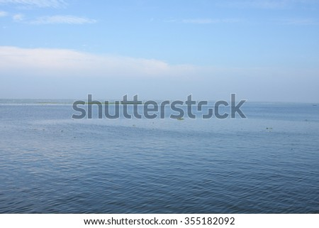Vembanad lake  is the longest lake in India,and the largest lake in the state of Kerala. It is also counted as one of the largest lakes in India.in famous backwaters of Kerala.  - stock photo