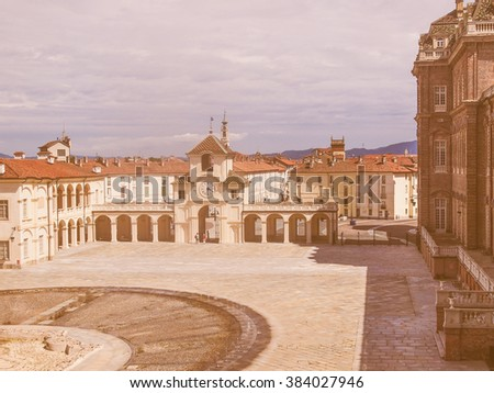 VENARIA, ITALY - JULY 30, 2014: Tourists visiting the Reggia baroque royal palace in Venaria Reale Turin Italy, vintage