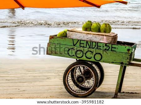Vende-se Coco: Coconut for sale in Brazil - stock photo
