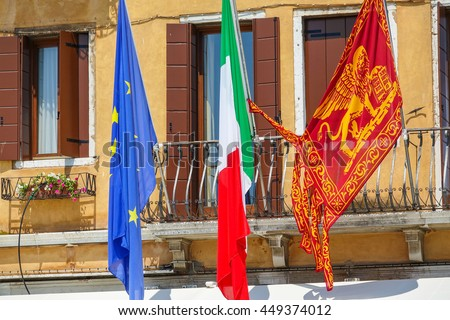 Venetian and European Flag in Venice - VENICE, ITALY - JUNE 28, 2016