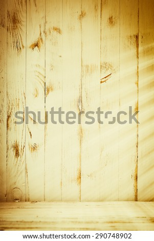 Venetian blinds sunlight on the shabby wooden wall - stock photo