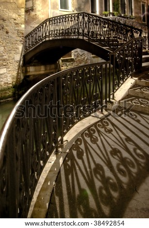 Venetian canal and brigde at night - stock photo