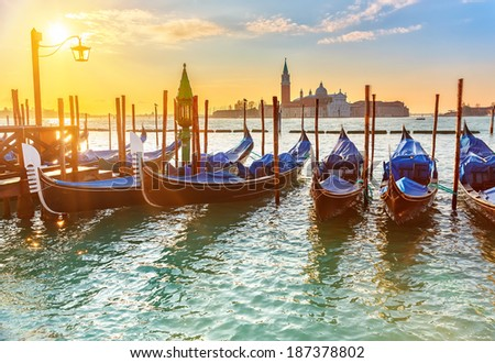Venetian gondolas at sunrise, Venice, Italy - stock photo
