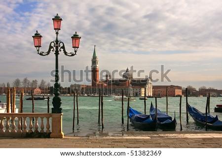 Venetian lamppost, gondolas on Grand Canal and San Giorgio Maggiore Church in Venice, Italy. - stock photo