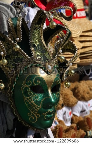 Venetian mask at a street souvenir stall in Venice, Italy - stock photo