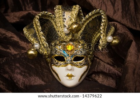 venetian mask on brown fabric