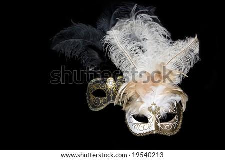 Venetian masks on black background - stock photo