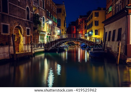 Venetian street in the night, bridge over canal, Italy