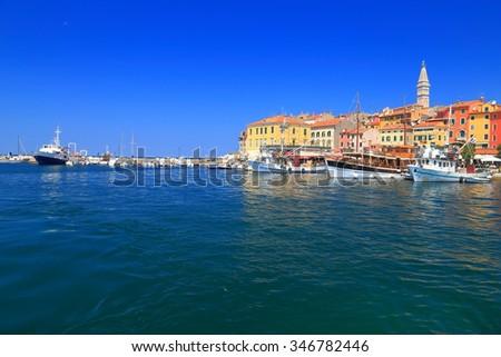 Venetian town with tall church on a hilltop near the Adriatic sea, Rovinj, Croatia - stock photo