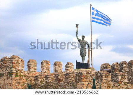 Venetian walls of Nefpaktos and national flag of Greece on a mast, Greece  - stock photo