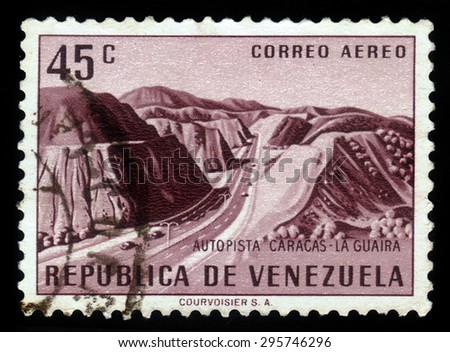 VENEZUELA - CIRCA 1956: a stamp printed in the Venezuela shows landscape of the Caracas La Guaira Highway, circa 1956 - stock photo