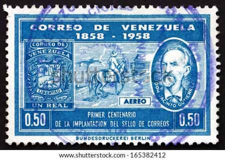 VENEZUELA - CIRCA 1959: a stamp printed in the Venezuela shows Mailman on Horseback and Don Jacinto Gutierrez, Centenary of Venezuelan Postage Stamps, circa 1959 - stock photo