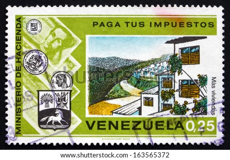 VENEZUELA - CIRCA 1974: a stamp printed in the Venezuela shows Suburban Housing Development, Pay Your Taxes Campaign, circa 1974 - stock photo