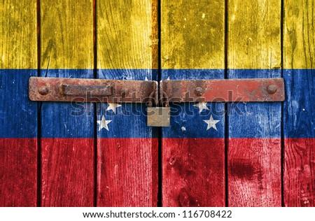 Venezuelan flag on the background of old locked doors - stock photo