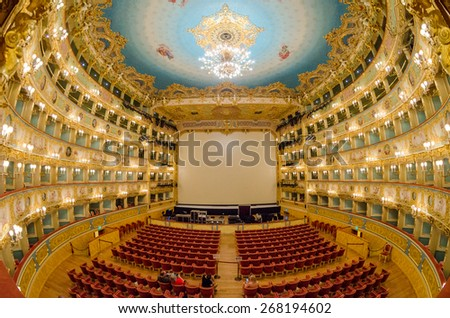 "VENICE - APRIL 7, 2014: Interior of La Fenice Theatre. Teatro La Fenice, ""The Phoenix"", is an opera house, one of the most famous and renowned landmarks in the history of Italian theatre. - stock photo"