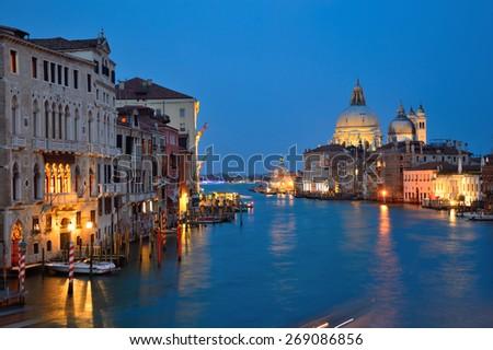 Venice at dusk, with beautiful basilica of Santa Maria della Salute in the background, Italy - stock photo