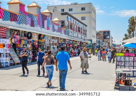 Venice Beach, California, USA - July 11, 2015: People walk along the Venice Beach Boardwalk on a sunny summer day. - stock photo