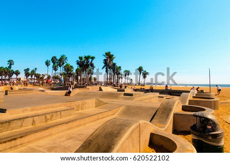 Venice Beach, Los Angeles, CA - September 25, 2015: Skatepark at world famous Venice Beach. The Skate Board Park with its concrete ramps and palm trees is very famous and popular in California.