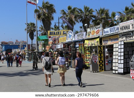 VENICE BEACH, UNITED STATES - APRIL 14, 2015 : the tourist shops on Venice beach walkway, in Los angeles, california, united states - stock photo