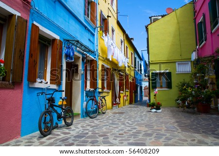 Venice, Burano island street with small colored houses and two bicycles,  Italy - stock photo