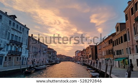 Venice - December 1 - Sunset from the Cannaregio Canal which has a red touch to the sky and the clouds.