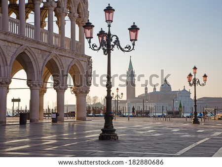 Venice - Doge palace and Saint Mark square and San Giorgio Maggiore church in background in morning light. - stock photo