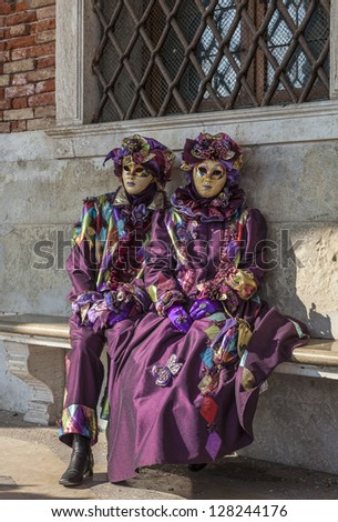 VENICE-FEB 18: Unidentified couple wearing sophisticate Venetian disguises on February 18, 2012 in Venice. In 2012 the Venice Carnival was held between February 11- 21.