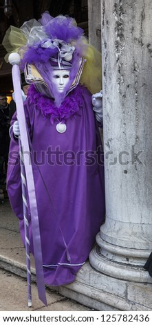 VENICE-FEB 18: Unidentified person wearing a sophisticate violet Venetian disguise on February 18, 2012 in Venice. In 2012 the Venice Carnival was held between 11- 21 February.