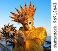VENICE - FEBRUARY 21: An unidentified person in a carnival costume attends the end Carnival of Venice,  February 21, 2012 in Venice, Italy. - stock photo