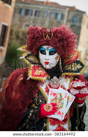 Venice - February 6, 2016: Colourful carnival mask through the streets of  Venice and in St. Mark's Square during celebration of the most famous carnival in the world.