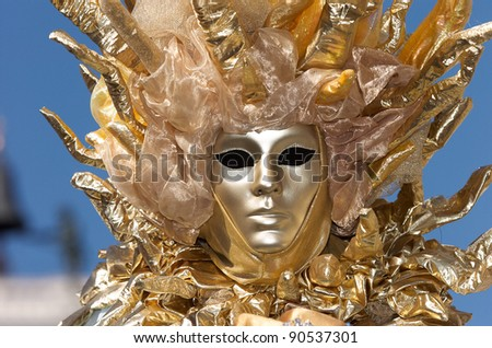 VENICE - FEBRUARY 17: Person in Venetian costume attends the Carnival of Venice, festival starting two weeks before Ash Wednesday and ends on Shrove Tuesday, on February 17, 2007 in Venice, Italy. - stock photo