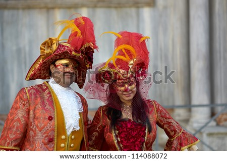 VENICE - FEBRUARY 21: Persons in Venetian costume attend the Carnival of Venice, festival starting two weeks before Ash Wednesday, on February 21, 2011 in Venice, Italy.