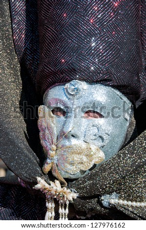 VENICE - FEBRUARY 03 : Unidentified man with black dress and silver mask during celebrations of the Venice Carnival on February 3, 2013.