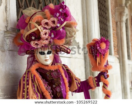 VENICE - FEBRUARY 17: Unidentified person in Venetian costume attends the Carnival of Venice, festival starting two weeks before Ash Wednesday, on February 17, 2011 in Venice, Italy.