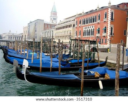 Venice gondolas and shoreline - stock photo