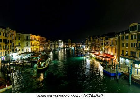 Venice Grand Canal near the Rialto bridge at night - Venice, Italy - stock photo