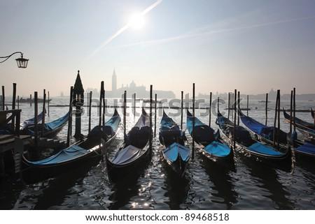 Venice in morning fog with gondolas in Italy - stock photo
