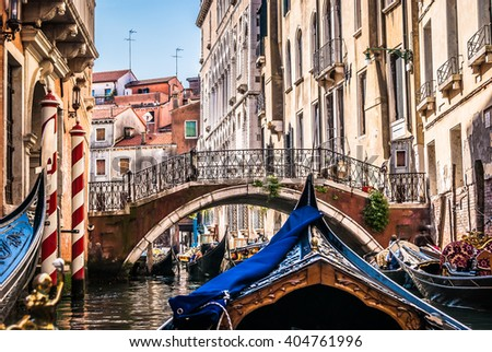 Venice is beautiful city and road with gondola is special way to see this wonderful streets on sea. / All about gondolas, Venice. - stock photo
