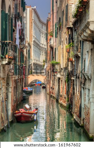 Venice, Italy. A romantic narrow canal and bridge among old Venetian architecture - stock photo