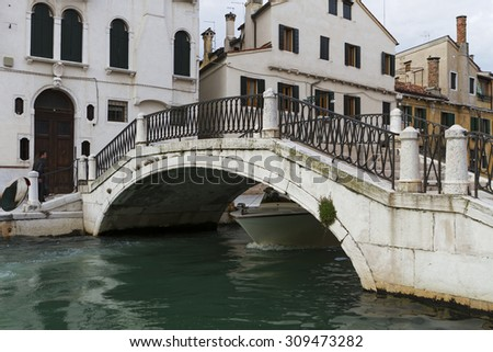 Venice, Italy - April 1, 2013: Street views of canals and ancient architecture in Venice, Italy. - stock photo
